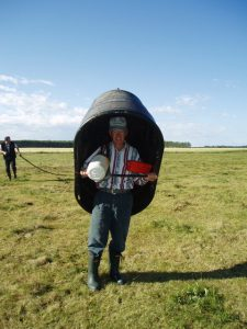 In Canada this farmer carries his mobile water trough to the next paddock on his back!